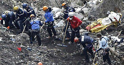 Recovery workers at the crash site in the alps