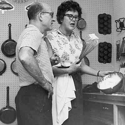 Julia and Paul Child in the kitchen