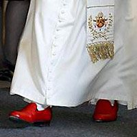 The Pope's red Prada shoes
