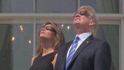 Donald and Melania with eclipse glasses